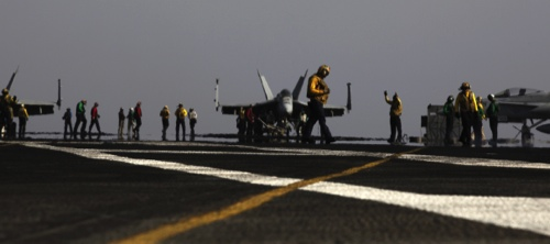U.S Navy sailors prepare an aircraft for missions targeting the Islamic State group in Iraq from the deck of the U.S. Navy aircraft carrier USS George H.W. Bush in the Persian Gulf