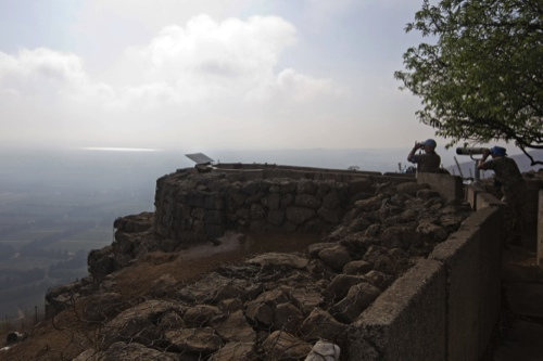 U.N. soldiers observe Syria's Quneitra province at an observation point on Mount Bental in the Israeli-controlled Golan Heights, overlooking the border with Syria
