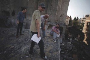 Palestinian filmmaker Khalil Mozayen,second right, speaks with a crew member during a rehearsal for his new movie in Gaza City