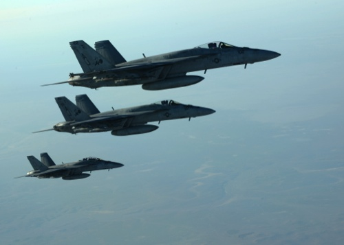 In this photo released by the U.S. Air Force, a formation of U.S. Navy F-18E Super Hornets leaves after receiving fuel from a KC-135 Stratotanker over northern Iraq, as part of U.S. led coalition airstrikes on the Islamic State group and other targets in Syria