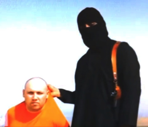 This image made from video released by Islamic State militants on Aug. 19, 2014 purports to show journalist Steven Sotloff being held by the militant group