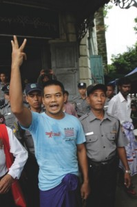 Activist Htin Kyaw, left, shouts as he is escorted by Myanmar polices after his trial at a district court in Yangon