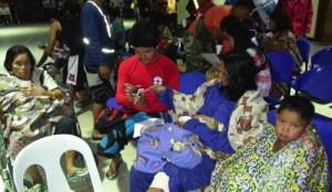 In this photo released by the Philippine National Red Cross Surigao Del Norte Chapter, survivors from the M/V Maharlika II ferry that keep themselves warm with blankets as they arrive at the Lipata Port Terminal in Surigao city, central Philippines