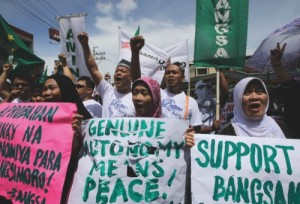 Filipino Muslims shout slogans during a rally near the Presidential Palace in support of the Bangsamoro Basic Law draft that was formally submitted by Philippine President Benigno Aquino III to both houses of Congress