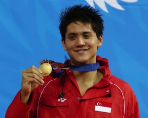 Singapore's Joseph Schooling holds up his gold medal