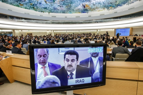 Mohammed Shia' al-Sudani, Iraqi Minister of Human Rights, is pictured on a TV screen during a statement at the special session on Iraq of the Human Rights Council, at the UN's European headquarters in Geneva