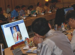 A portrait of Thai military junta chief and newly-appointed Prime Minister Gen. Prayuth Chan-ocha is shown on the television screen during the first cabinet meeting at Government House in Bangkok