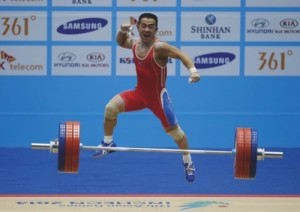 Om Yun Chol of North Korea reacts after making a good lift during the men's 56kg weightlifting competition at the 17th Asian Games in Incheon