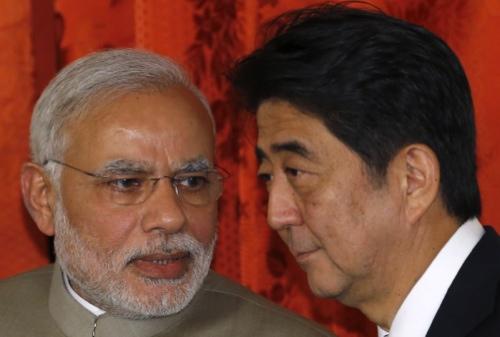 Narendra Modi, India's Prime Minister, left, speaks to Shinzo Abe, Japan's Prime Minister