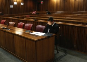 Oscar Pistorius sits in court before the fourth day of sentencing proceedings in the high court in Pretoria