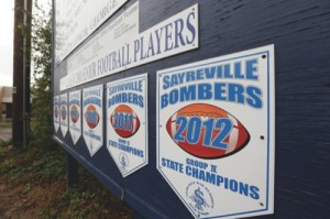 Banners for state championships for the Sayreville War Memorial High School football team are lined up on a sign along Main Street in Sayreville, N.J.