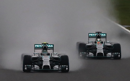 Mercedes driver Nico Rosberg of Germany, left, leads Mercedes driver Lewis Hamilton of Britain