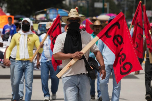 Masked students protest the disappearance of 43 fellow classmates from the Isidro Burgos rural teachers college in Chilpancingo