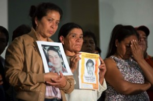 Parents of missing students holding pictures of the disappeared, attend a press conference after a meeting with Mexico's President Enrique Pena Nieto in Mexico City