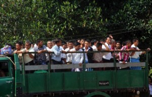 Myanmar prisoners ride a truck as they were released from Insein prison yesterday