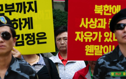 A North Korean defector attends a press conference demanding the improvement of North Korean's human rights, in front of National Human Rights Commission of Korea