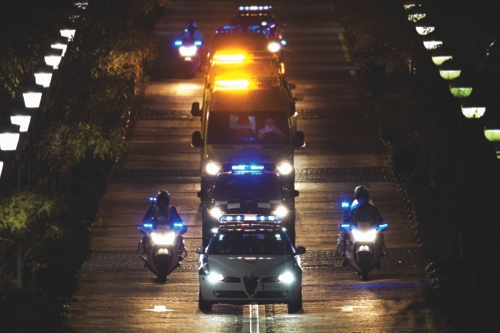 A convoy transporting a Spanish nurse who believed to have contracted the ebola virus from a 69-year-old Spanish priest leaves Alcorcon Hospital in Madrid