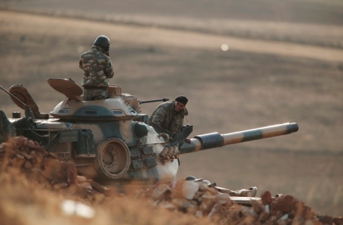 Turkish soldiers hold their positions with their tank on a hilltop on the outskirts of Suruc, at the Turkey-Syria border, overlooking Kobani, Syria