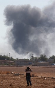 Smoke rises after an airstrike in Kobani, Syria as fighting intensified between Syrian Kurds and the militants of Islamic State group