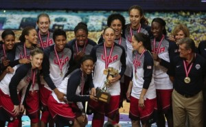 The United States basketball players and coach Geno Auriemma, right, pose with their trophy and gold medals following their victory over Spain in the Basketball Championship Women's final at Fenerbahce Arena in Istanbul, Turkey