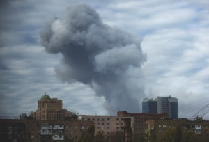 Smoke rises after yesterday's shelling in the city of Donetsk