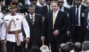 Pakistan's Prime Minister Nawaz Sharif, center right, arrives at the swearing in ceremony for India's Prime Minister Narendra Modi, and other members of the cabinet at the presidential palace in New Delhi