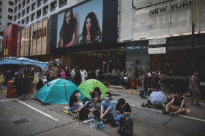 Demonstrators gather on Canton Road in the shopping area of Tsim Sha Tsui in Hong Kong