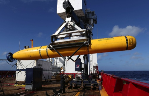 The Phoenix International Autonomous Underwater Vehicle Artemis is craned over the side of Australian Defence Vessel Ocean Shield in the search for missing Malaysia Airlines flight MH 370 on April 17, 2014