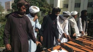 Taliban fighters turning over their weapons