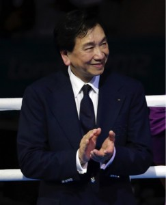 Wu Ching-Kuo, the president of amateur boxing's governing body participates in a medal ceremony for women's middleweight 75kg boxing at the 2012 Summer Olympics, in London