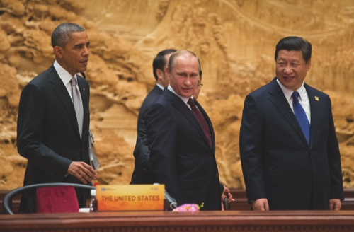 U.S. President Barack Obama, left, Chinese President Xi Jinping, right, and Russian President Vladimir Putin, center, arrive at the APEC Summit plenary session at the International Convention Center, Yanqi