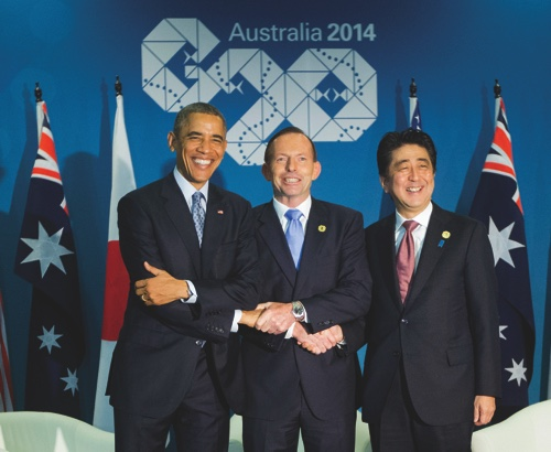 U.S. President Barack Obama, left, Australian Prime Minister Tony Abbott, center, and Japanese Prime Minister Shinzo Abe, right, shake hands at the start of their meeting at the G20 Summit in Brisbane