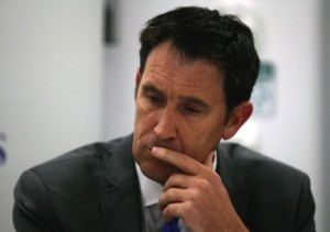 James Sutherland, chief executive of Cricket Australia, listens to a statement being read by Australia cricket captain Michael Clarke following the death of fellow cricketer Phillip Hughes during a press conference at St. Vincent's Hospital in Sydney