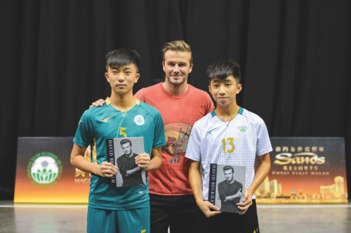 David Beckham awards the best players from each team at a community event Sunday organised by the Sands China Community Academy