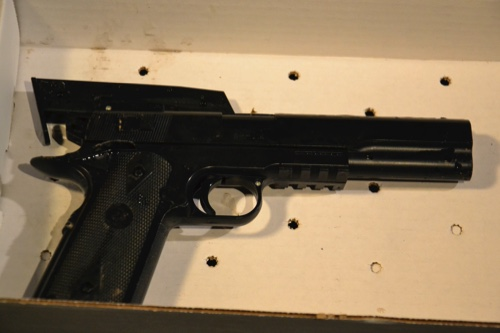 A BB gun taken from a 12-year old Tamir E. Rice, inset, and Cleveland police investigating a scene after an officer fired two shots, killing the 12-year-old