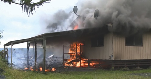 Lava flow from the Kilauea Volcano burns a residential structure