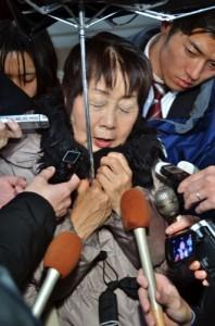 Chisako Kakehi is surrounded by reporters in Sakai, western Japan