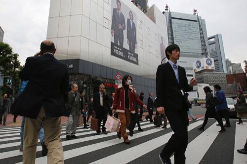 People walk on a pedestrian crossing in Tokyo