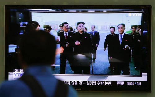 A man watches a TV news program at the Seoul Railway Station in Seoul, South Korea, showing North Korean leader Kim Jong Un