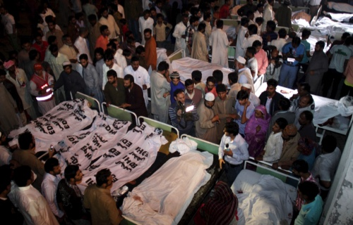 Pakistanis gather to identify bodies of their relatives killed in a bomb blast, at a local hospital in Lahore