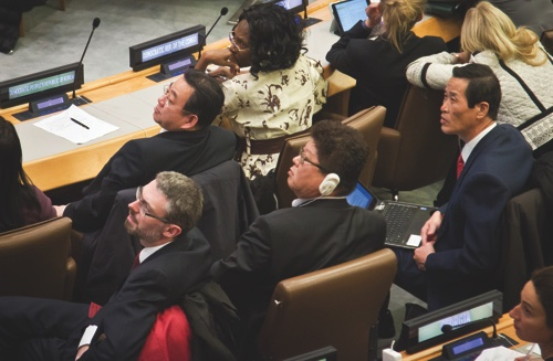 Choe Myong Nam, second from left, North Korea's official in charge of U.N. affairs and human rights, and other delegates watch the recorded votes on a draft proposal during a meeting of the U.N. General Assembly human rights committee