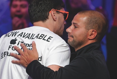 Dan Sindelar, right, embraces Mark Newhouse after Newhouse was knocked out of the World Series of Poker Final Table
