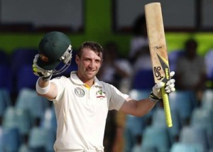 Australia's Phillip Hughes celebrates after scoring a century during the fourth day's play of the third Test between Australia and Sri Lanka in Colombo