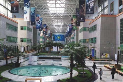 People walk through the centrul atrium at Nazarbayev University, Almaty, Kazakhstan