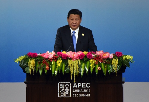 China's President Xi Jinping delivers an opening speech of the APEC CEO Summit as part of the Asia-Pacific Economic Cooperation (APEC) Summit at the China National Convention Center in Beijing