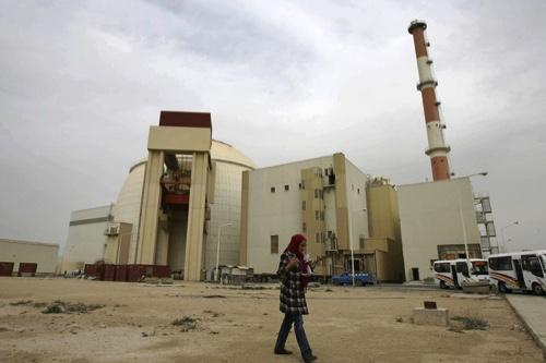 An Iranian journalist walks outside the Bushehr nuclear power plant in Bushehr