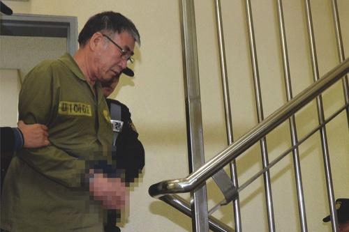 Lee Joon Seok, the captain of the sunken S. Korea ferry Sewol arrives at the Gwangju District Court