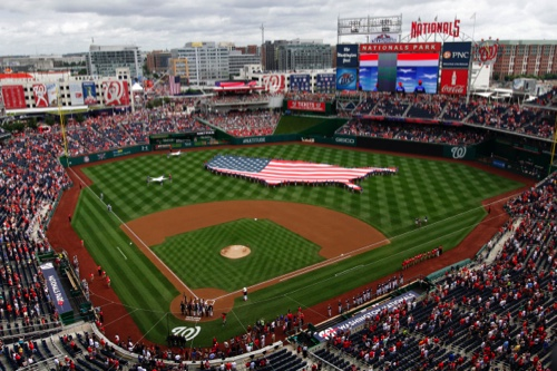 A U.S. flag, in the shape of the country, in the outfield before a baseball game between the Washington Nationals and the Milwaukee Brewers at Nationals Park in Washington