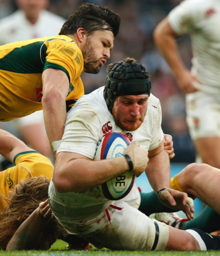 England's Ben Morgan, and crosses the line to score a try held by while being held Australia's Adam Ashley-Cooper