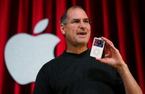 In this Oct. 12, 2005 file photo, Apple Computer Inc. CEO Steve Jobs holds up an iPod during an event in San Jose, Calif.